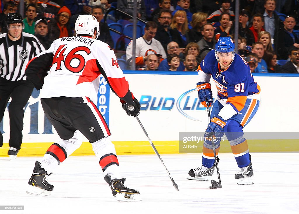 <a gi-track='captionPersonalityLinkClicked' href=/galleries/search?phrase=John+Tavares&family=editorial&specificpeople=601791 ng-click='$event.stopPropagation()'>John Tavares</a> #91 of the New York Islanders skates against Patrick Wiercioch #46 of the Ottawa Senators during their game at Nassau Veterans Memorial Coliseum on March 3, 2013 in Uniondale, New York.