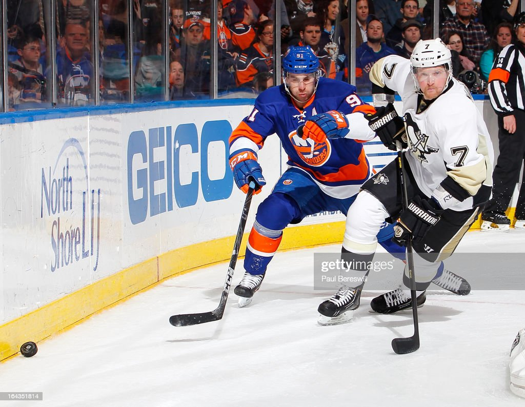<a gi-track='captionPersonalityLinkClicked' href=/galleries/search?phrase=John+Tavares&family=editorial&specificpeople=601791 ng-click='$event.stopPropagation()'>John Tavares</a> #91 of the New York Islanders skates against Paul Martin #7 of the Pittsburgh Penguins in an NHL hockey game at Nassau Veterans Memorial Coliseum on March 22, 2013 in Uniondale, New York.