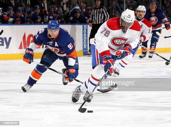 John Tavares of the New York Islanders skates against PK Subban of the Montreal Canadiens at Nassau Veterans Memorial Coliseum on February 9 2012 in...