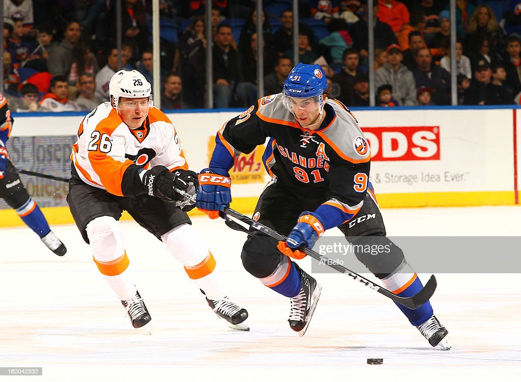 John Tavares #91 of the New York Islanders skates against Ruslan Fedotenko #26 of the Philadelphia Flyers during their game at Nassau Veterans Memorial Coliseum on February 18, 2013 in Uniondale, New York.