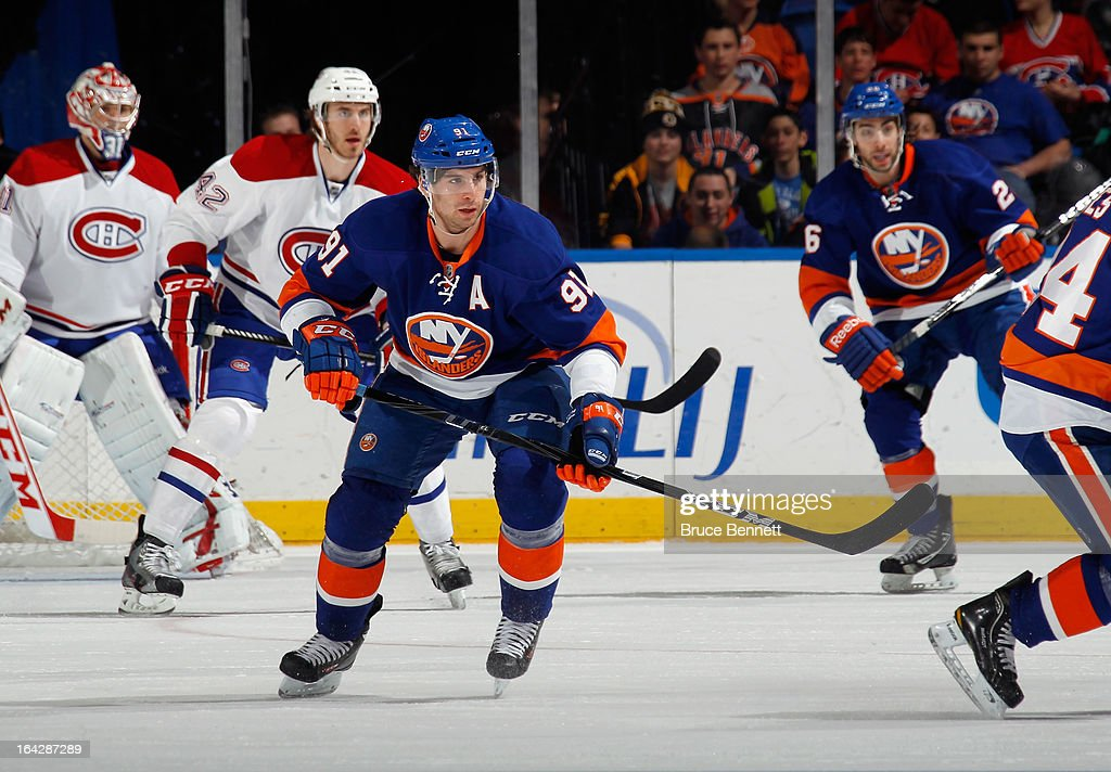 <a gi-track='captionPersonalityLinkClicked' href=/galleries/search?phrase=John+Tavares&family=editorial&specificpeople=601791 ng-click='$event.stopPropagation()'>John Tavares</a> #91 of the New York Islanders skates against the Montreal Canadiens at the Nassau Veterans Memorial Coliseum on March 21, 2013 in Uniondale, New York.The Canadiens defeated the Islanders 5-2.