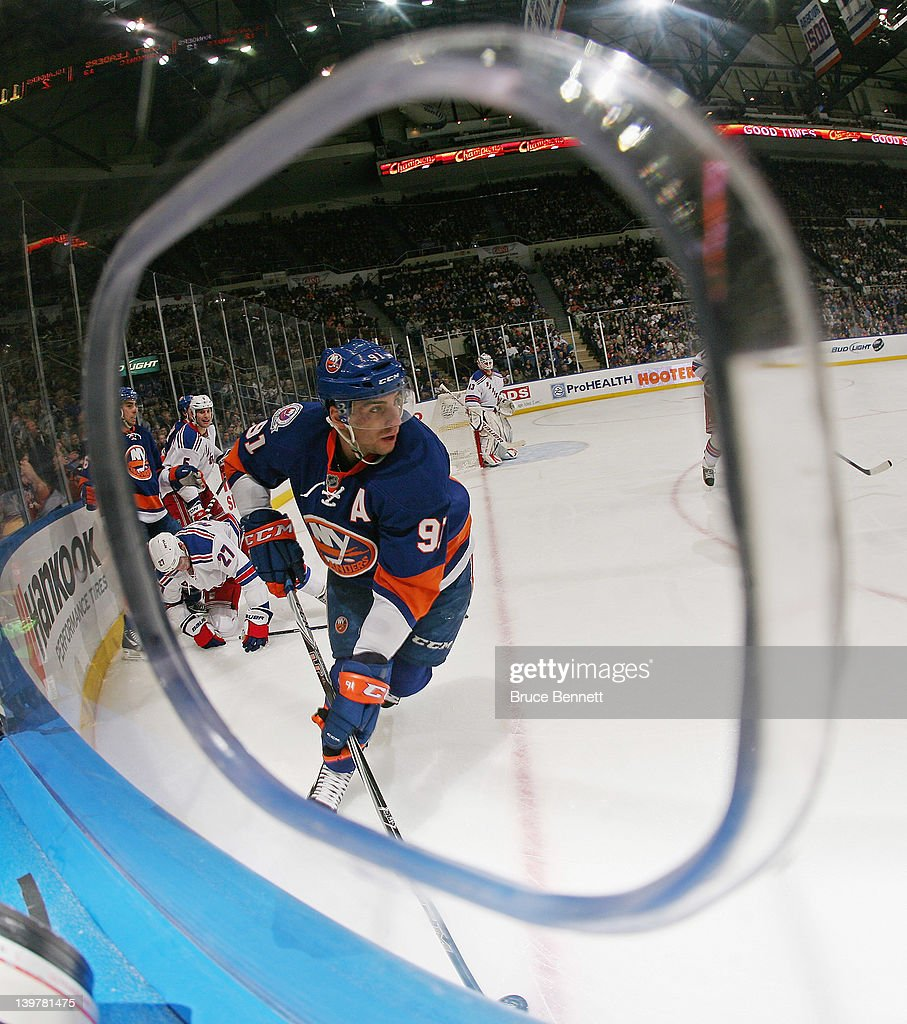 <a gi-track='captionPersonalityLinkClicked' href=/galleries/search?phrase=John+Tavares&family=editorial&specificpeople=601791 ng-click='$event.stopPropagation()'>John Tavares</a> #91 of the New York Islanders skates against the New York Rangers at the Nassau Veterans Memorial Coliseum on February 24, 2012 in Uniondale, New York.