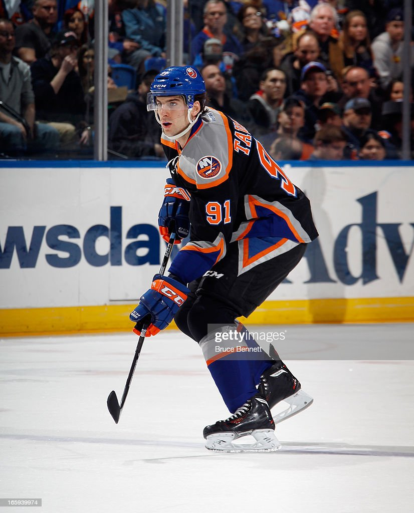 <a gi-track='captionPersonalityLinkClicked' href=/galleries/search?phrase=John+Tavares&family=editorial&specificpeople=601791 ng-click='$event.stopPropagation()'>John Tavares</a> #91 of the New York Islanders skates against the Tampa Bay Lightning at the Nassau Veterans Memorial Coliseum on April 6, 2013 in Uniondale, New York. The Islanders defeated the Lightning 4-2.