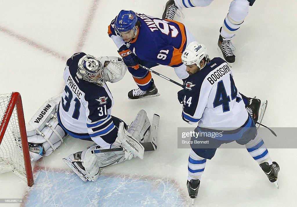 John Tavares #91 of the New York Islanders skates against the Winnipeg Jets at the Nassau Veterans Memorial Coliseum on April 2, 2013 in Uniondale, New York.