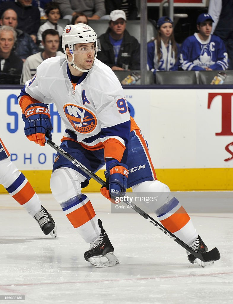 <a gi-track='captionPersonalityLinkClicked' href=/galleries/search?phrase=John+Tavares&family=editorial&specificpeople=601791 ng-click='$event.stopPropagation()'>John Tavares</a> #91 of the New York Islanders skates during NHL game action against the Toronto Maple Leafs April 18, 2013 at the Air Canada Centre in Toronto, Ontario, Canada.