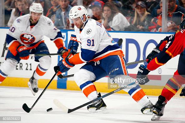 John Tavares of the New York Islanders skates with the puck during second period action against the Florida Panthers in Game Five of the Eastern...