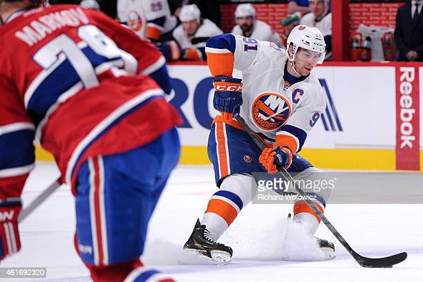John Tavares of the New York Islanders stops with the puck during the NHL game against the Montreal Canadiens at the Bell Centre on January 17 2015...