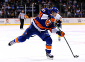 John Tavares of the New York Islanders takes a shot in the second period against the Nashville Predators at the Barclays Center on October 15 2015 in...