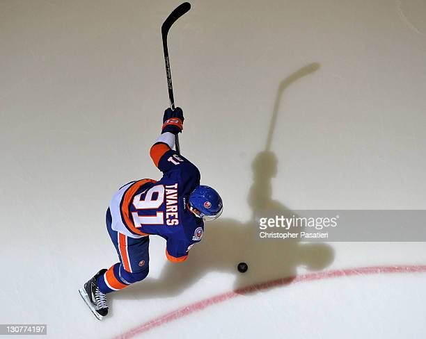 John Tavares of the New York Islanders takes a shot on goal during the first period against the San Jose Sharks at Nassau Coliseum on October 29 2011...