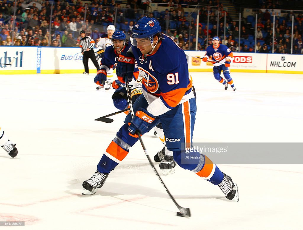 John Tavares #91 of the New York Islanders takes a slapshot against the Buffalo Sabres during their game at Nassau Veterans Memorial Coliseum on February 9, 2013 in Uniondale, New York.