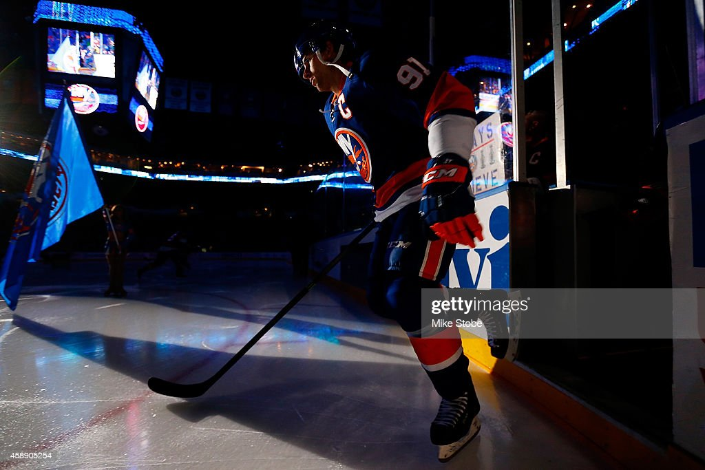 <a gi-track='captionPersonalityLinkClicked' href=/galleries/search?phrase=John+Tavares&family=editorial&specificpeople=601791 ng-click='$event.stopPropagation()'>John Tavares</a> #91 of the New York Islanders takes the ice prior to the game against the Winnipeg Jets at Nassau Veterans Memorial Coliseum on October 28, 2014 in Uniondale, New York. The Winnipeg Jets defeated the New York Islanders 4-3.