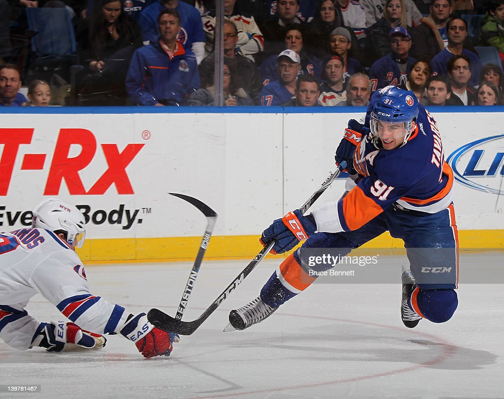 <a gi-track='captionPersonalityLinkClicked' href=/galleries/search?phrase=John+Tavares&family=editorial&specificpeople=601791 ng-click='$event.stopPropagation()'>John Tavares</a> #91 of the New York Islanders takes the shot against the New York Rangers at the Nassau Veterans Memorial Coliseum on February 24, 2012 in Uniondale, New York.