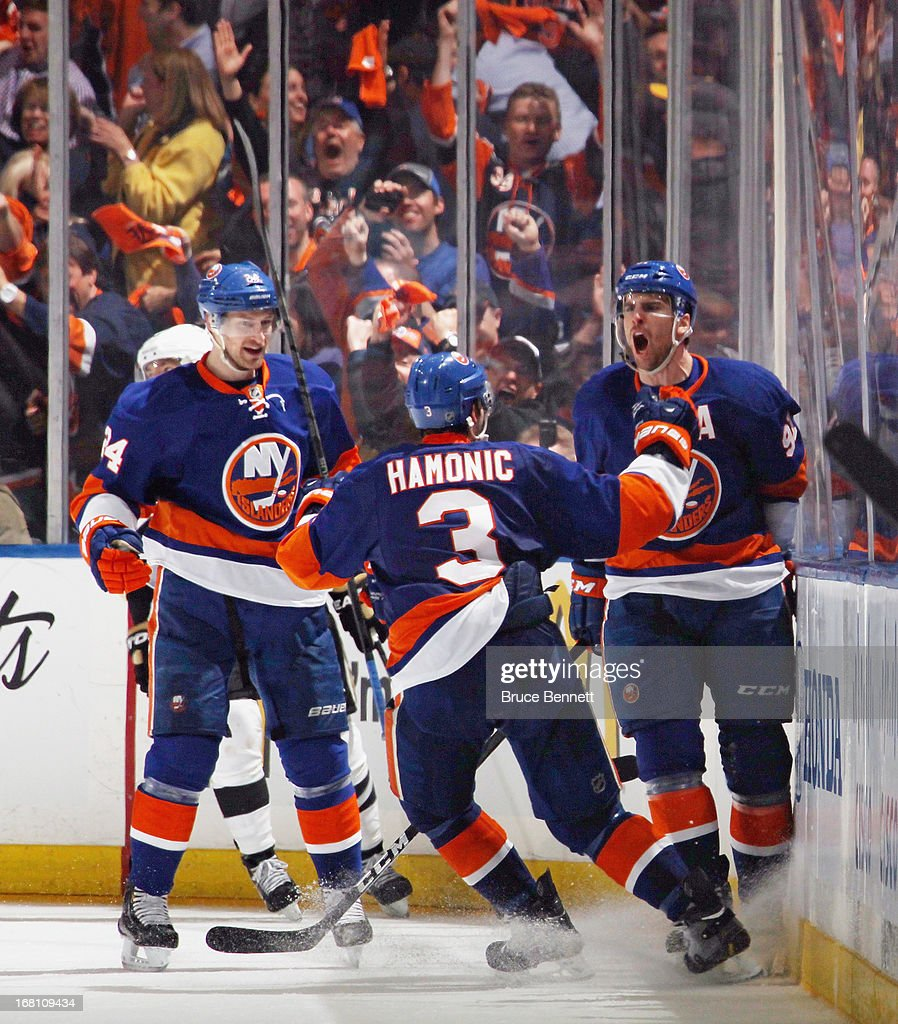 John Tavares #91 of the New York Islanders (R) ties the score at 4-4 against the Pittsburgh Penguins at 10:48 of the third period and is joined by Brad Boyes #24 (L) and Travis Hamonic #3 (C) in Game Three of the Eastern Conference Quarterfinals during the 2013 NHL Stanley Cup Playoffs at the Nassau Veterans Memorial Coliseum on May 5, 2013 in Uniondale, New York.
