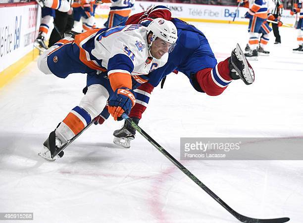 John Tavares of the New York Islanders tries to keep the puck from the Montreal Canadiens in the NHL game at the Bell Centre on November 5 2015 in...