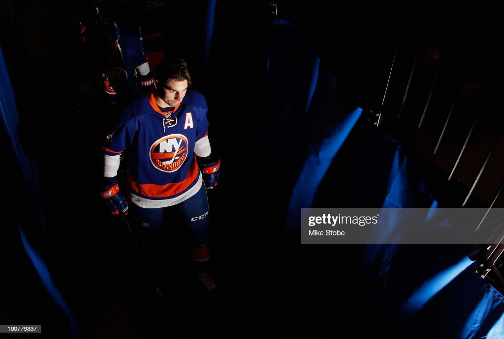John Tavares #91 of the New York Islanders walks out for warm ups prior to the game against the Pittsburgh Penguins at Nassau Veterans Memorial Coliseum on Febuary 5, 2013 in Uniondale, New York.