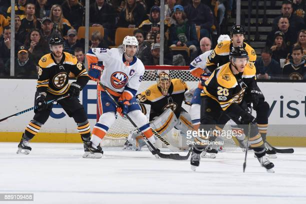 John Tavares of the New York Islanders watches the play against Kevan Miller Tuukka Rask Riley Nash and Zdeno Chara of the Boston Bruins at the TD...