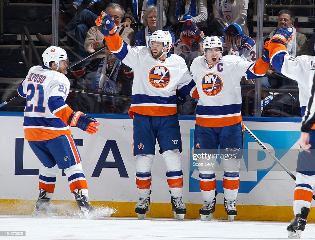 <a gi-track='captionPersonalityLinkClicked' href=/galleries/search?phrase=John+Tavares&family=editorial&specificpeople=601791 ng-click='$event.stopPropagation()'>John Tavares</a> #91, <a gi-track='captionPersonalityLinkClicked' href=/galleries/search?phrase=Thomas+Vanek&family=editorial&specificpeople=570606 ng-click='$event.stopPropagation()'>Thomas Vanek</a> #26 and <a gi-track='captionPersonalityLinkClicked' href=/galleries/search?phrase=Kyle+Okposo&family=editorial&specificpeople=540469 ng-click='$event.stopPropagation()'>Kyle Okposo</a> #21 of the New York Islanders react after a third-period goal against the New York Rangers at Madison Square Garden on January 21, 2014 in New York City.