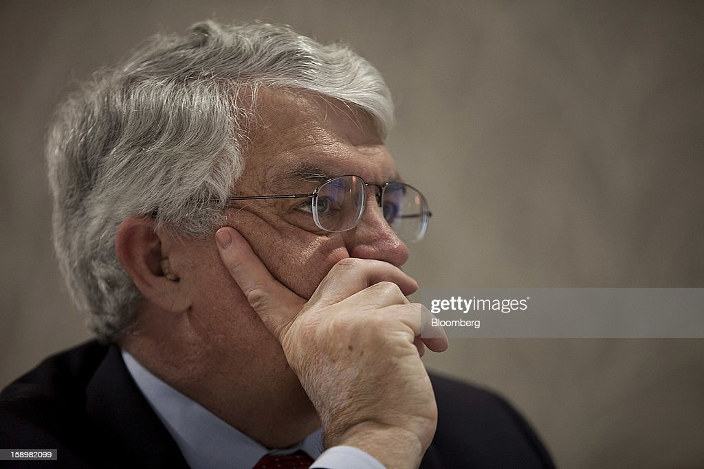 John Taylor, a professor of economics at Stanford University, listens at the American Economic Association's annual meeting in San Diego, California, U.S., on Friday, Jan. 4, 2013. One day after the Federal Reserve put forth dates at which it might end $85 billion a month of bond purchases, James Bullard, president of the Federal Reserve Bank of St. Louis, described the economic conditions that may warrant a halt to the policy. Photographer: Sam Hodgson/Bloomberg via Getty Images