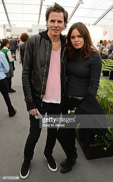 John Taylor and daughter Atlanta de Cadenet attend VIP Preview of the Frieze Art Fair 2014 in Regent's Park on October 14 2014 in London England