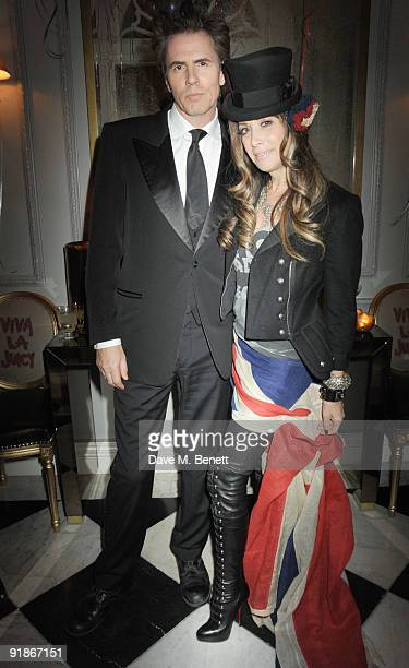 John Taylor and Gela NashTaylor attend the Juicy Couture VIP launch party on October 13 2009 in London England