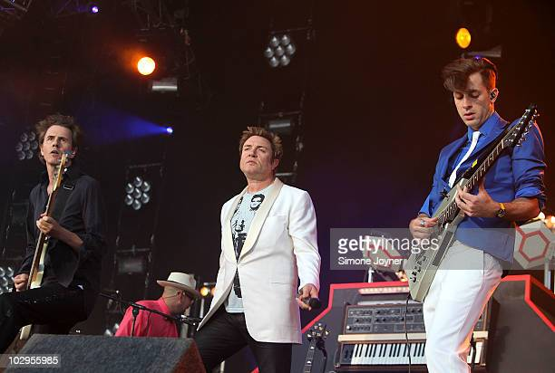 John Taylor and Simon Le Bon of Duran Duran join Mark Ronson as he performs live on the main stage during day two of the Love Box Weekender 2010 at...
