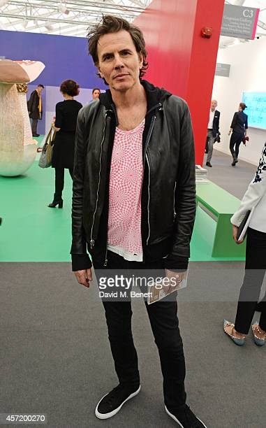 John Taylor attends VIP Preview of the Frieze Art Fair 2014 in Regent's Park on October 14 2014 in London England
