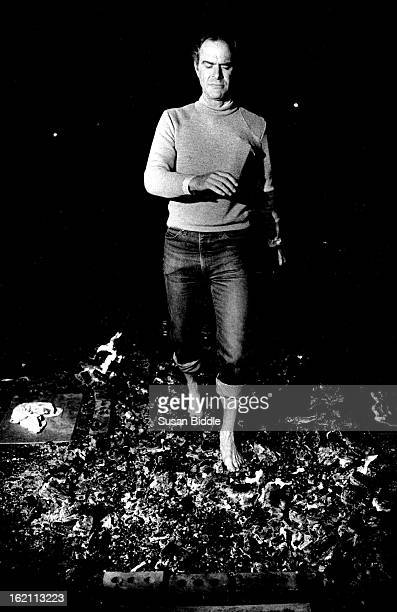 APR 14 1987 John Taylor CU Professor of physics walks on burning hot coals on CU St *****