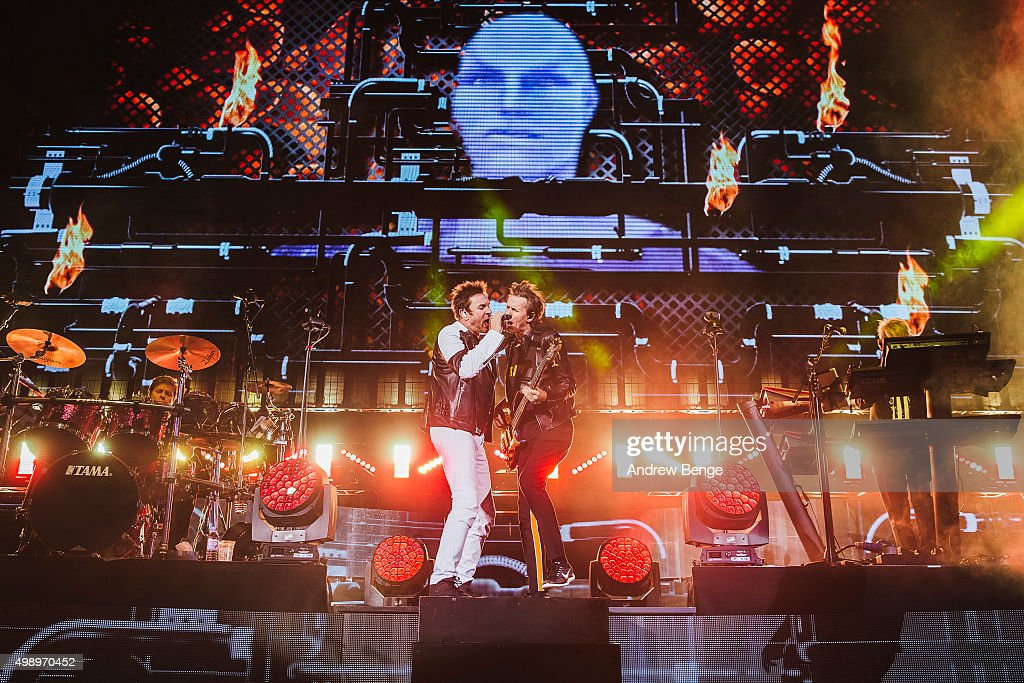 John Taylor Simon Le Bon and Nick Rhodes of Duran Duran perform on stage at Manchester Arena on November 27 2015 in Manchester England