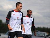 John Terry and Ashley Cole look on during the England training session at London Colney on August 9 2011 in St Albans England