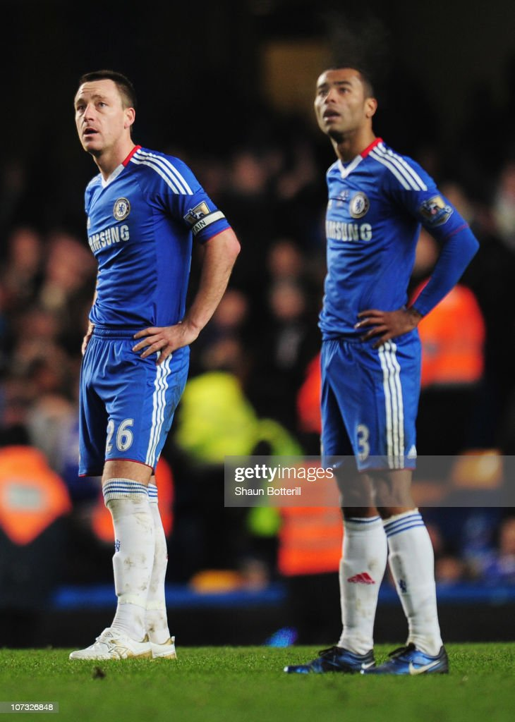 John Terry and Ashley Cole of Chelsea look dejected as Jermaine Beckford of Everton scores an equalizing goal during the Barclays Premier League...