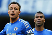 John Terry and Ashley Cole of Chelsea look on during the Barclays Premier League match between Chelsea and Norwich City at Stamford Bridge on October...