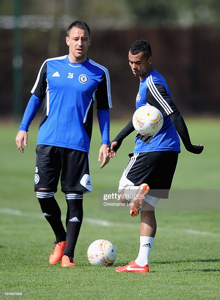 John Terry and Ashley Cole warm up during a training session at Cobham Training Centre on May 1 2013 in Cobham England