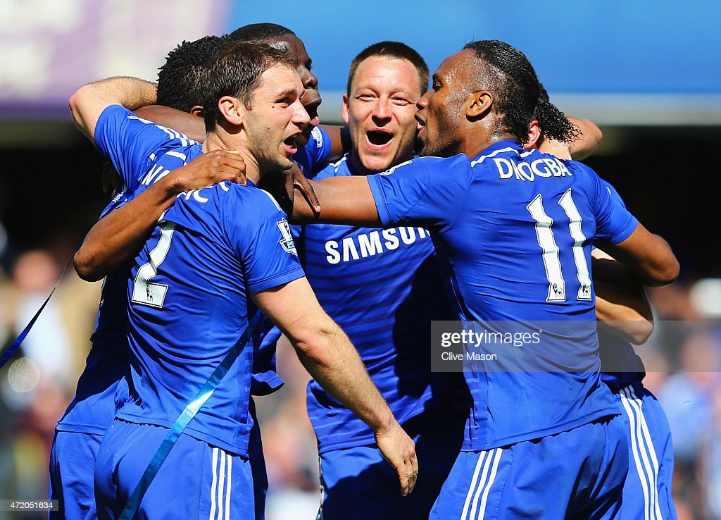 John Terry (C) and Branislav Ivanovic (L) and Didier Drogba of Chelsea (R) celebrate winning the Premier League title after the Barclays Premier League match between Chelsea and Crystal Palace at Stamford Bridge on May 3, 2015 in London, England. Chelsea became champions with a 1-0 victory.
