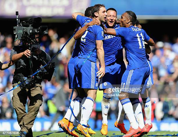 John Terry and Branislav Ivanovic and Didier Drogba of Chelsea celebrate winning the Premier League title after the Barclays Premier League match...
