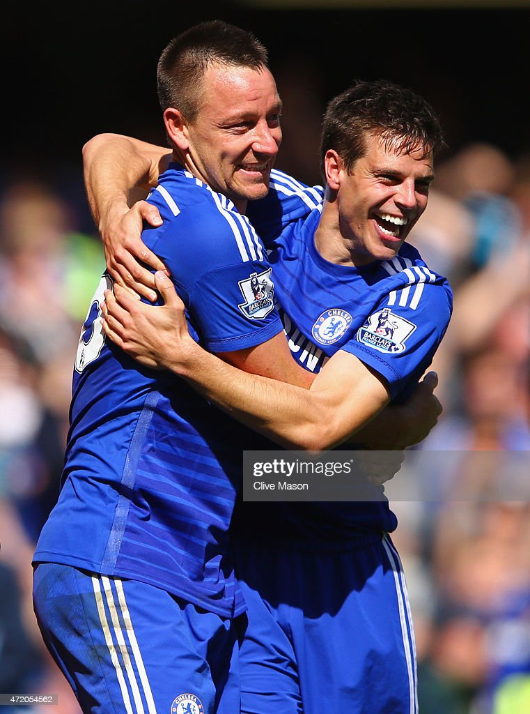 John Terry (L) and Cesar Azpilicueta celebrate winning the Premier League title after the Barclays Premier League match between Chelsea and Crystal Palace at Stamford Bridge on May 3, 2015 in London, England. Chelsea became champions with a 1-0 victory.