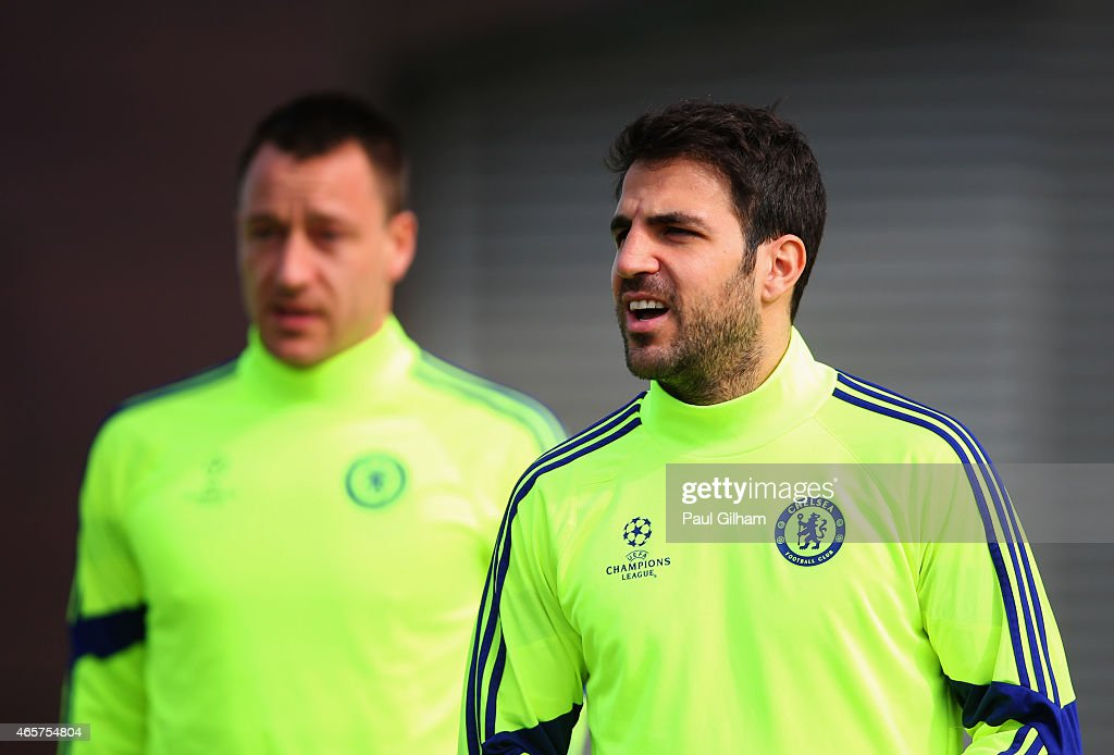 John Terry and Cesc Fabregas look on during a Chelsea training session ahead of the UEFA Champions League Round of 16 second leg match against Paris...