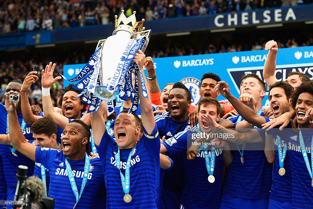 John Terry and Didier Drogba of Chelsea lift the trophy in celebration after the Barclays Premier League match between Chelsea and Sunderland at...