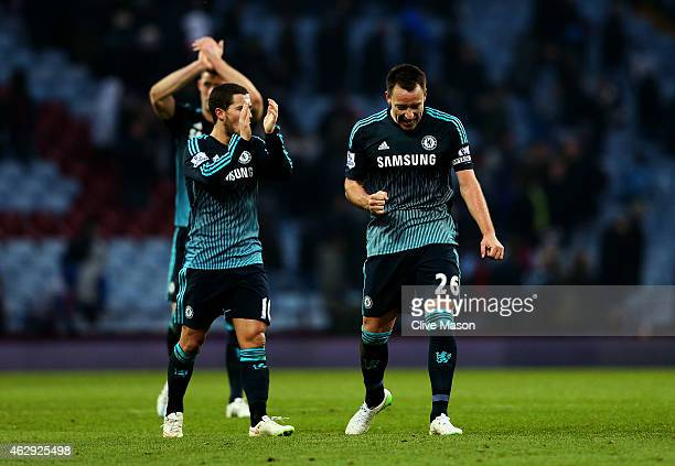 John Terry and Eden Hazard of Chelsea celebrate victory after the Barclays Premier League match between Aston Villa and Chelsea at Villa Park on...