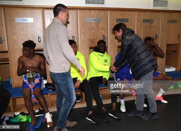 John Terry and first team coach Antonio Conte speaks to the players following victory in the FA Youth Cup Final second leg between Chelsea and...