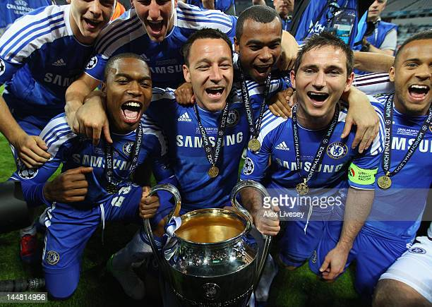 John Terry and Frank Lampard of Chelsea hold the trophy in celebration and celebrate with team mates after their victory in the UEFA Champions League...