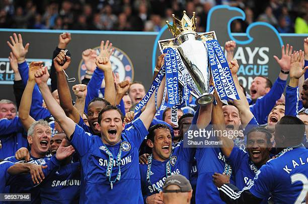John Terry and Frank Lampard of Chelsea lift the trophy after the Barclays Premier League match between Chelsea and Wigan Athletic at Stamford Bridge...