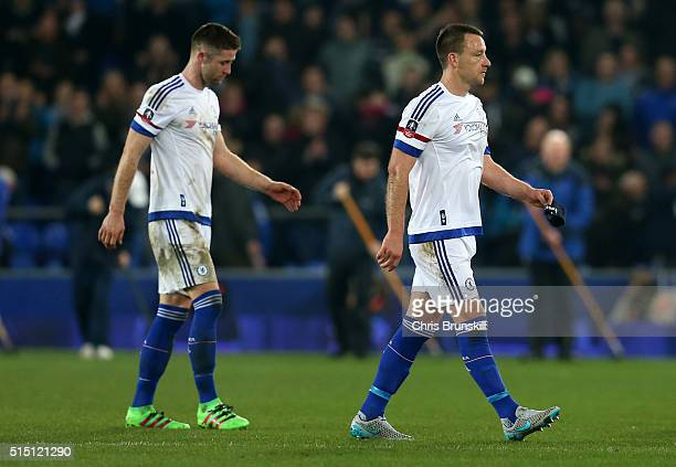 John Terry and Gary Cahill of Chelsea leave the pitch after his team's 02 defeat in the Emirates FA Cup sixth round match between Everton and Chelsea...