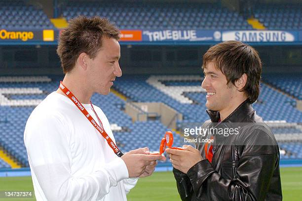 John Terry and Joe Cole during The Interactive Hand Held Football Game 'Match Master' Launch April 24 2006 at Stamford Bridge in London Great Britain