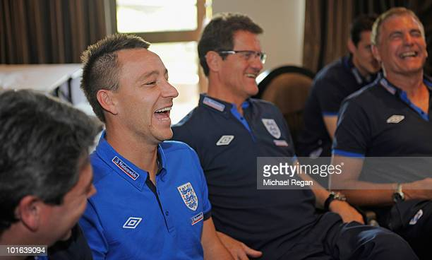 John Terry and manager Fabio Capello share a laugh with Prince William via video link after the England training session at the Royal Bafokeng Sports...