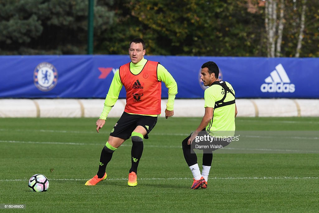 John Terry and Pedro of Chelsea during a training session at Chelsea Training Ground on October 21, 2016 in Cobham, England.