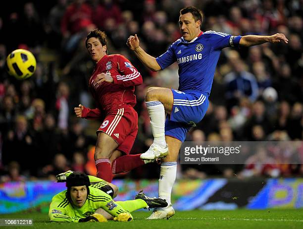 John Terry and Petr Cech of Chelsea are unable to stop Fernando Torres of Liverpool scoring the opening goal during the Barclays Premier League match...