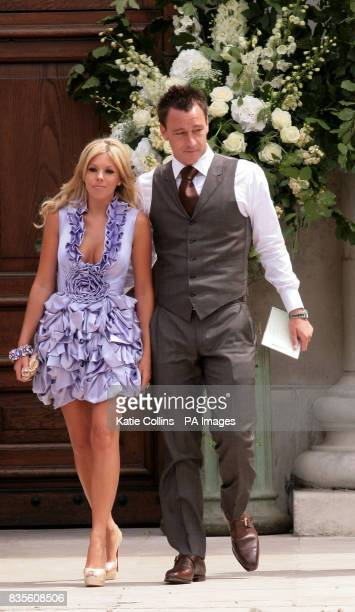 John Terry and wife Toni Poole outside the Royal Hospital where England and Chelsea FC footballer Joe Cole and Carly Zucker are due to get married...