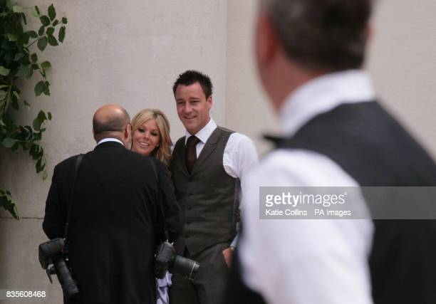 John Terry and wife Toni pose for photographer Richard Young outside the Royal Hospital where England and Chelsea FC footballer Joe Cole and Carly...