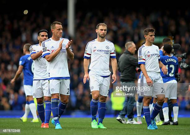 John Terry Branislav Ivanovic and Cesar Azpilicueta of Chelsea look dejected after the Barclays Premier League match between Everton and Chelsea at...