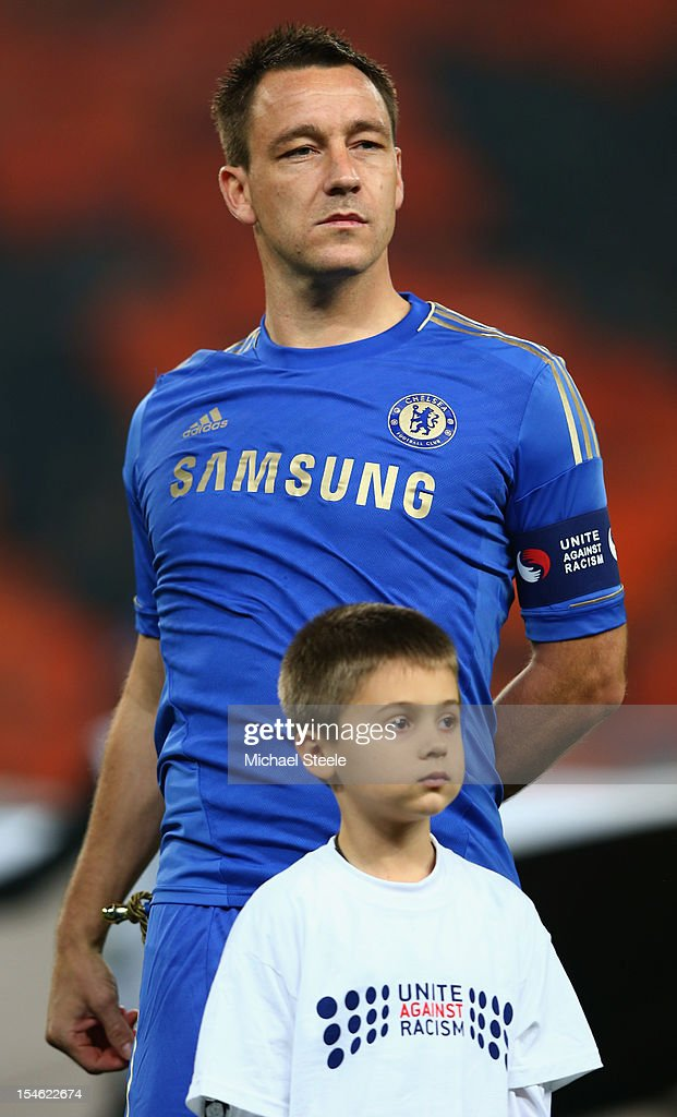 John Terry captain of Chelsea wears a 'Unite against Racism' arm band alongside a young mascot to highlight UEFA's FARE Action Week campaign during the UEFA Champions League Group E match between Shakhtar Donetsk and Chelsea at the Donbass Arena on October 23, 2012 in Donetsk, Ukraine.